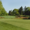 View of a bunkered green at Champions Golf Course